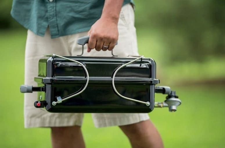 Carrying Portable Grill In Hand